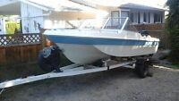 MUST SELL- In town for 1 week - 14' motor boat with canvas cover