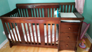Crib with changing table. Converts to toddler bed