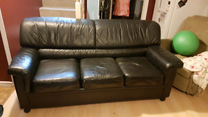 Black leather sofa and loveseat can deliver