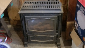 Natural gas space heater/fireplace.