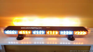 Warning emergency vehicle lighting for tow truck construction