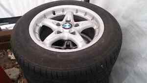 Very decent 195 65 15 tires on BMW rims. Great for all 320's.