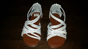 Girls Size 11.5 white colored shoes with clear silvery circles