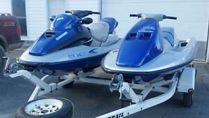 2 sea doo's with double trailer