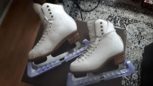 FIGURE SKATES AND SKATE GUARDS FOR SALE