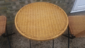 Folding wicker table and two chairs. Good condition £50.00. Lincoln ar