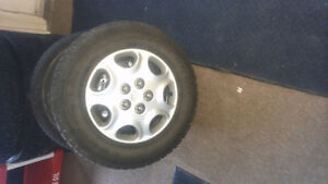 LIKE NEW GOODYEAR NORDIC SNOW TIRES ON RIMS