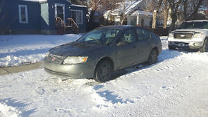 2005 Saturn ION Sedan... comes with winter and summer tires