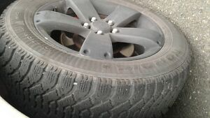 (4) P235/55R17 Goodyear Notdic Winter Tires on Saturn Wheels St. John's Newfoundland image 1