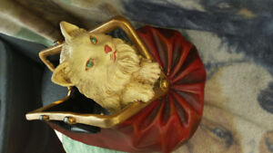 Wonderful cat in a suitcase inside/Outside decor.