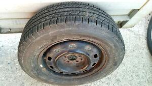 4 x 205/65R15 BFGoodrich all season tires on rims over 80% tread