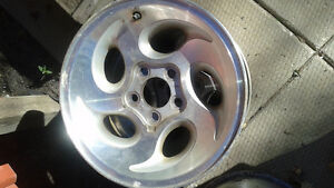 Set of four rims for a Ford