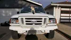 Looking for 04-05 front and rear white bumpers