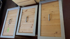 Three wooden drawers