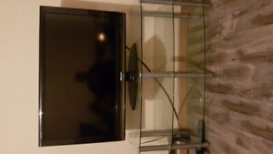 """40"""" widescreen TV and stand"""