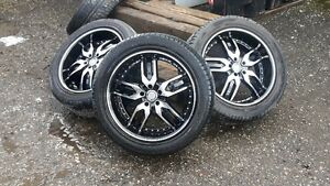 """20"""" x 8.5"""" rims with tires mounted"""