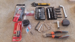 Tool sets wrenches measuring tape screws glue permanent markers