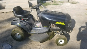 "Rider lawnmower Poulan  10.5HP 30"" $950   1 YR OLD"