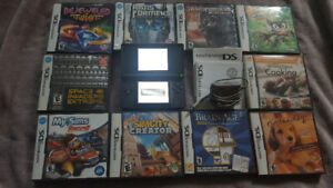 Red and black nintendo ds system with many games