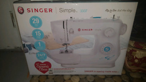 Sewing machine  new condition. Sherwood park