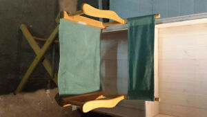 Canvas and solid wood directors chair folds for storage.