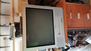 "Toshiba 21"" flat screen tv with integrated VCR player + Remote."