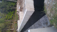Foundation waterproofing and driveway sealing