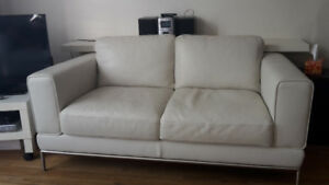Loveseat and ottoman in white leather