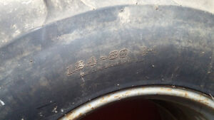Duals tractor tires 18.4 - 30 on T-Rail rims, with new binders