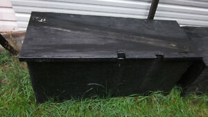 wooden dry box. has hinges and a lid. painted/ carpeted.