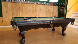 All wood pool table with leather pockets