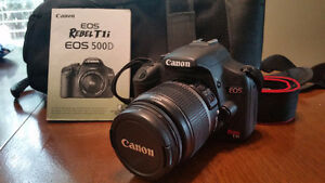 Canon Rebel T1i SLR camera with 250mm zoom lens