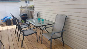 Outdoor glass and grey metal table and 6 chairs
