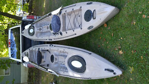 Amazing deal on 2 Equinox Fishing Kayaks with paddles