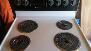 White and black oven in mint condition coil burners $85 obo