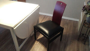 Leather Dining rm chairs, black with wood, coffee table, patio..
