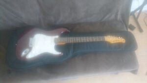 Jay Turser electric guitar - soft case and new strings