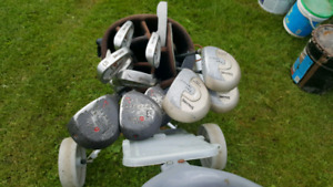 Golf clubs with bag and cart. Mixed clubs
