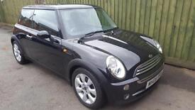 Mini Cooper. WARRANTY. HALF LEATHER. HEATED SEATS. ALLOYS.