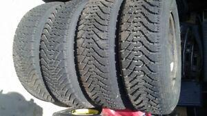 Set of 4- 205/75-14 Snow tires on Rims.