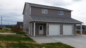 3 bedroom home with heated garage  available now