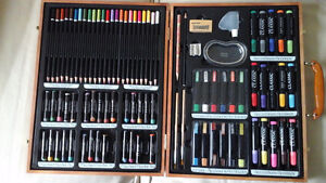 Artist Painting tools in a wooden box, books, frames of all kind