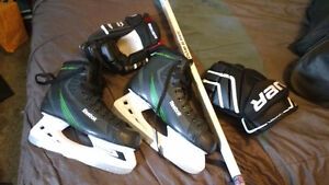 Skates, gloves and hockey stick