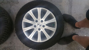 Set of 4 205/60/16 winter tires and Rims off Ford Fusion