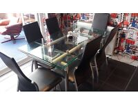 Glass extending dining table with six chairs