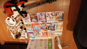 Wii console + 17 games + lots of accessories