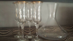 Wine decanter and 4  gold rimmed champagne glasses