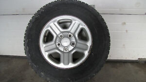 Set of four 245-70-R16 snows on OEM Jeep rims