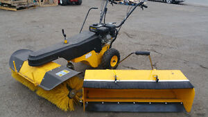 Snow Sweeper with pick up containment