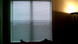4 wood faux window blinds ...9 mts. old ..white like new 64x72